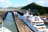 The 2 cruise ships entering Pedro Miguel Locks