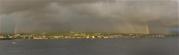 Two sides of rainbow leaving Kona, Hawai'i