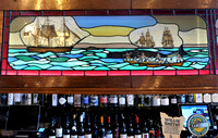 Part of the stained glass along the bar in The Whaler